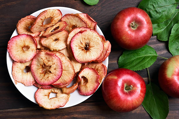 apple chips, top view - dried food stock photos and pictures