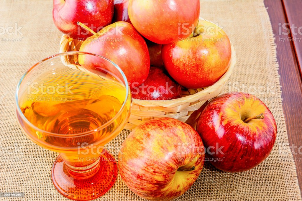 Apple cider glass and red apples stock photo