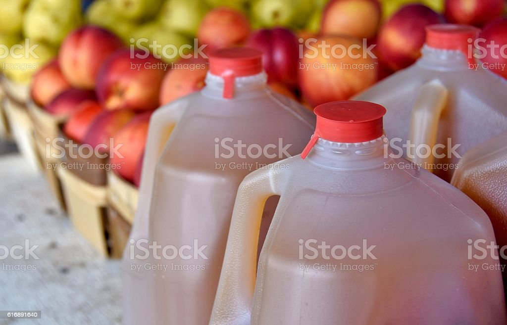 apple cider in gallon jugs stock photo