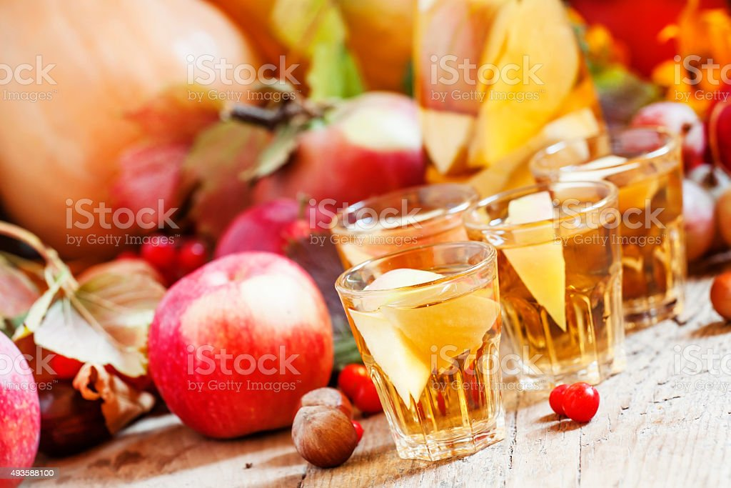 Apple cider in the autumn background stock photo