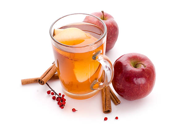 apple cider cup od apple cider and rolls of cinnamon hot apple cider stock pictures, royalty-free photos & images
