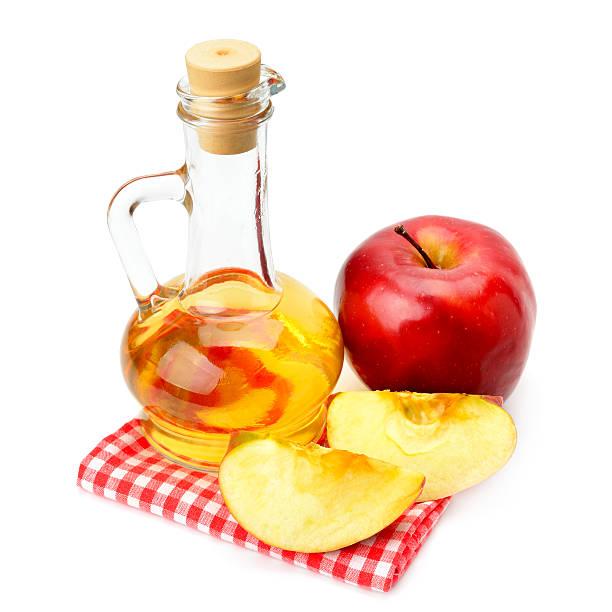 apple cider vinegar and apples stock photo
