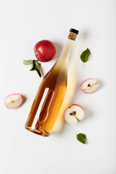 Apple cider vinegar and fresh apples, flat lay, space for your text. Top view. stock photo
