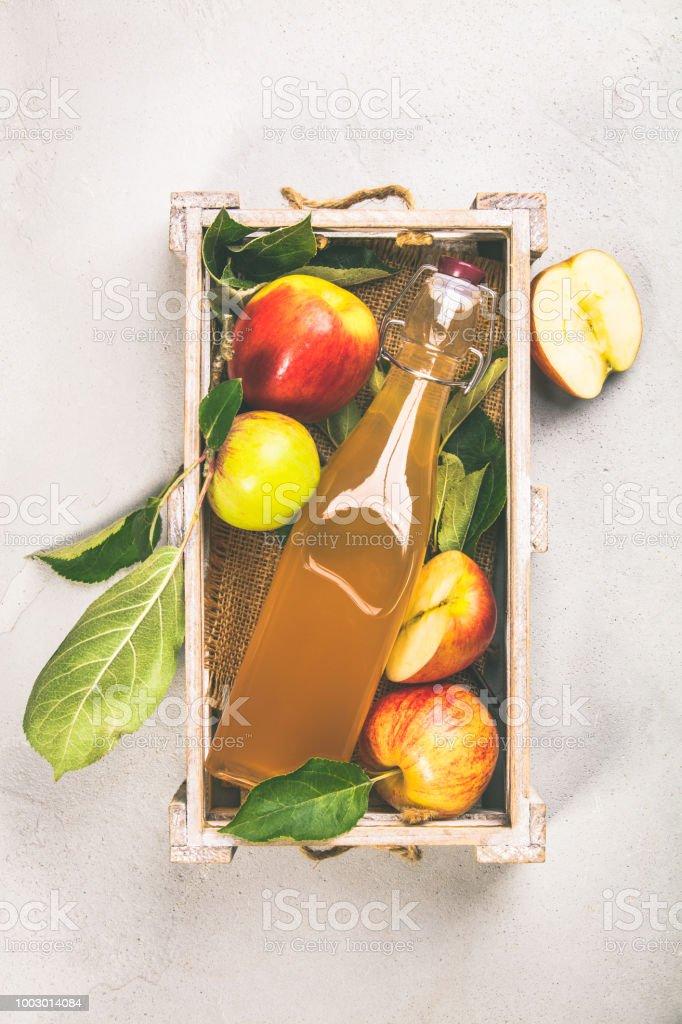 Apple cider vinegar and fresh apples stock photo