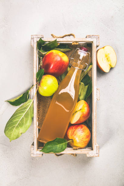Apple cider vinegar and fresh apples stock photo