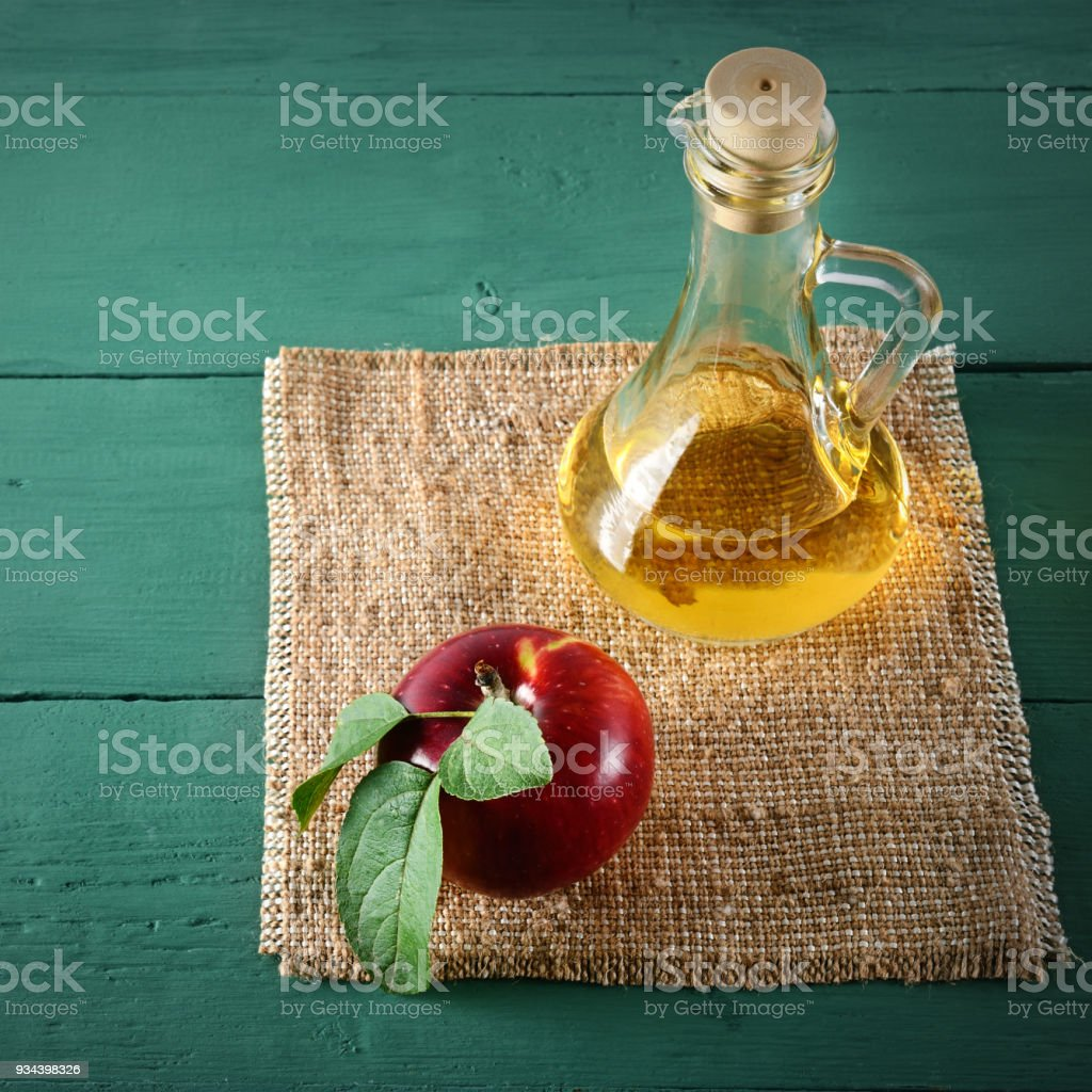 Apple cider vinegar and ripe red apples stock photo