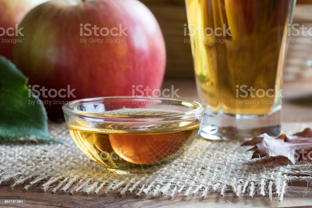 Apple cider vinegar in a glass bowl stock photo