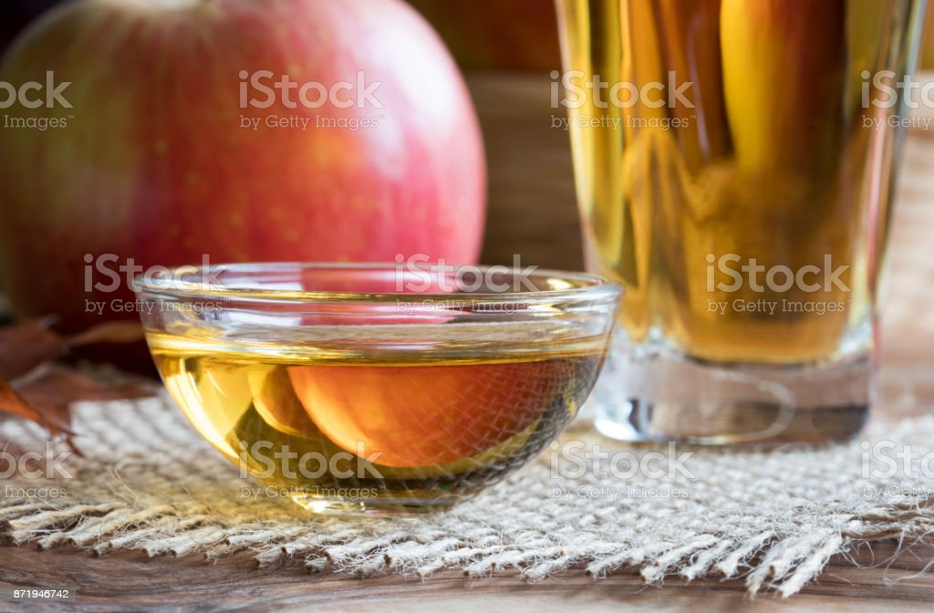 Apple cider vinegar in a glass bowl stock photo
