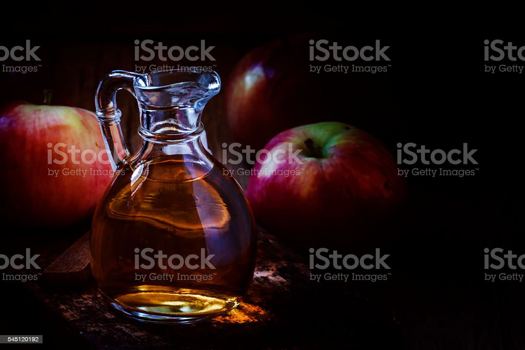 Apple cider vinegar in a glass jug stock photo