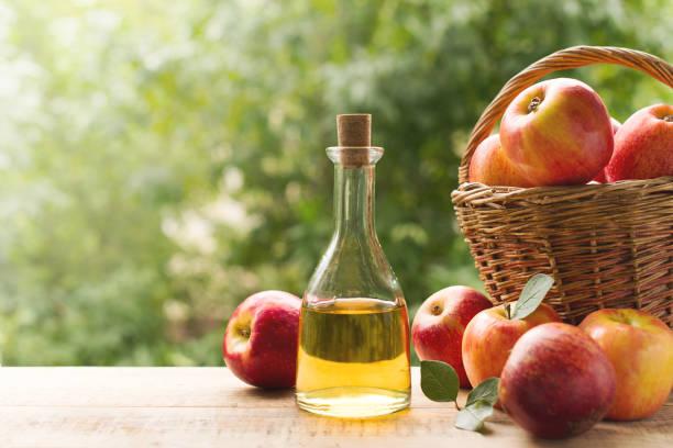 Apple cider vinegar in bottle with apple stock photo