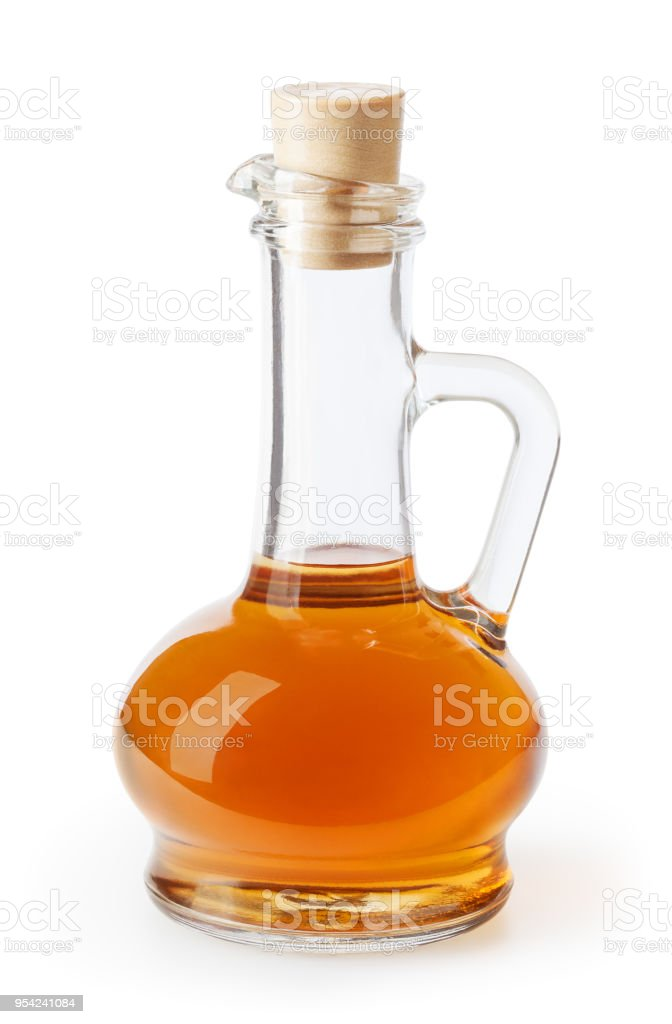Apple cider vinegar in glass bottle isolated on white background with clipping path stock photo