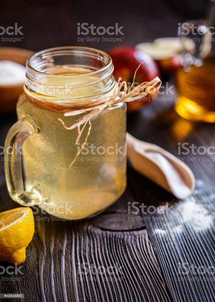 Apple cider vinegar, lemon and baking soda drink stock photo