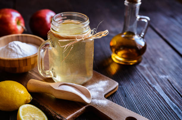 Apple cider vinegar, lemon and baking soda drink Detox drink made of water, apple cider vinegar, lemon juice and baking soda apple cider vinegar stock pictures, royalty-free photos & images