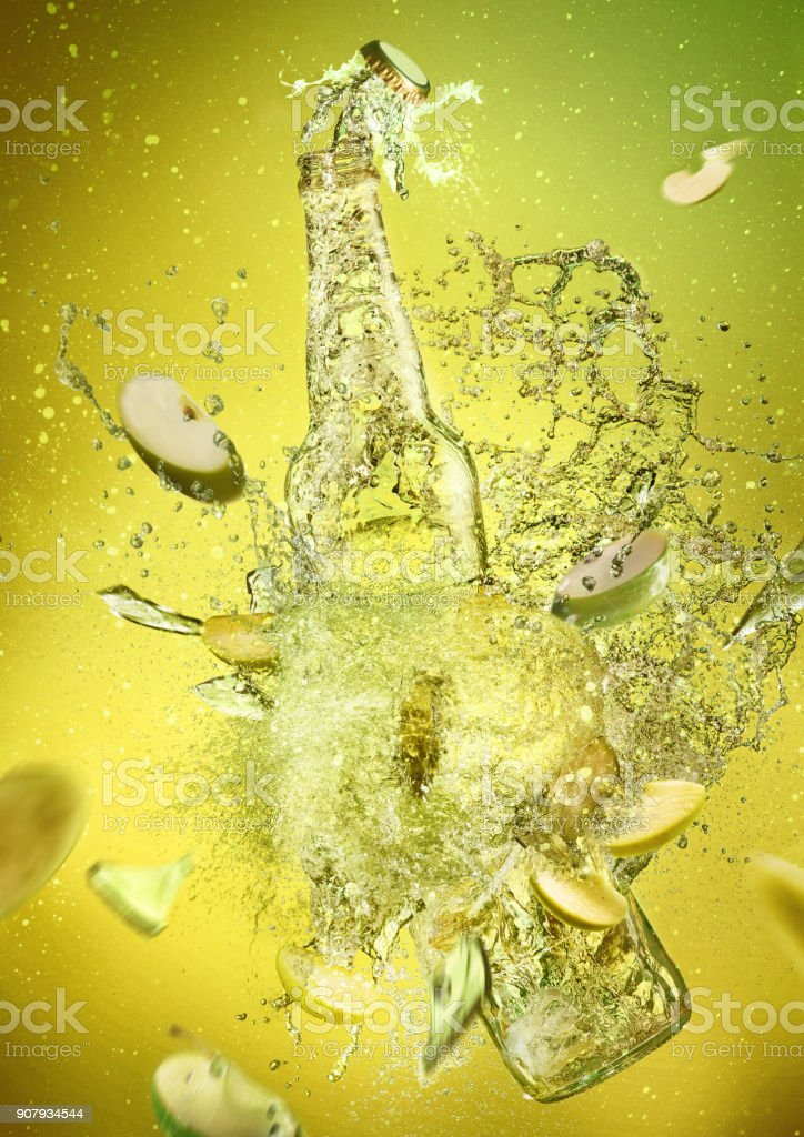 Apple cider vinegar on green stock photo