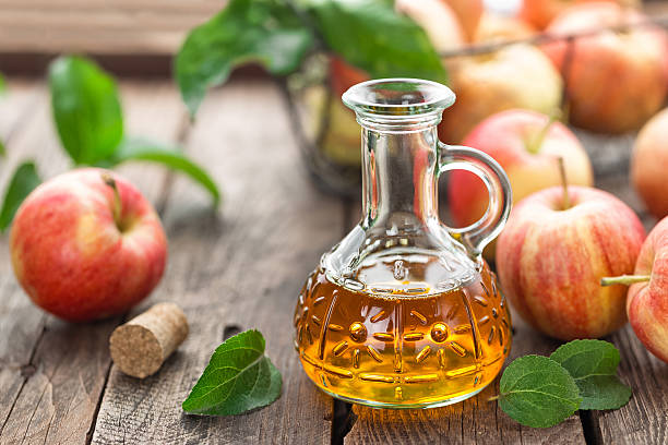 apple cider vinegar apple cider vinegar apple cider vinegar stock pictures, royalty-free photos & images