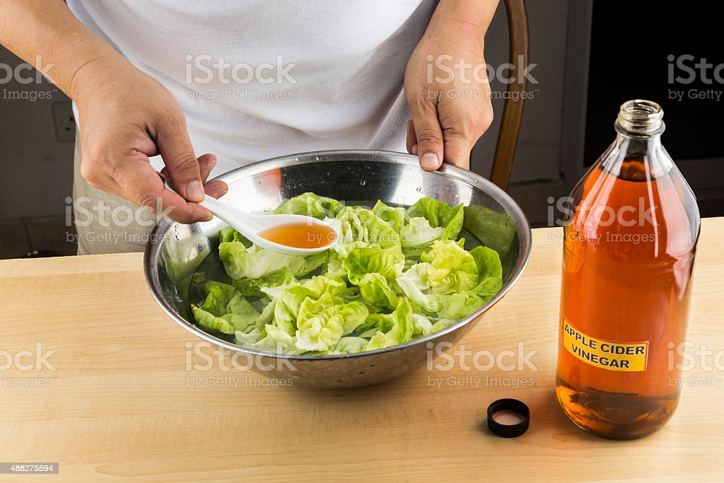 Apple Cider Vinegar to soak vegetable and remove pesticide residue stock photo