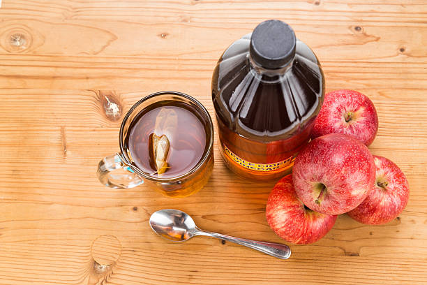 Apple cider vinegar with brewed tea, natural remedies and cures stock photo