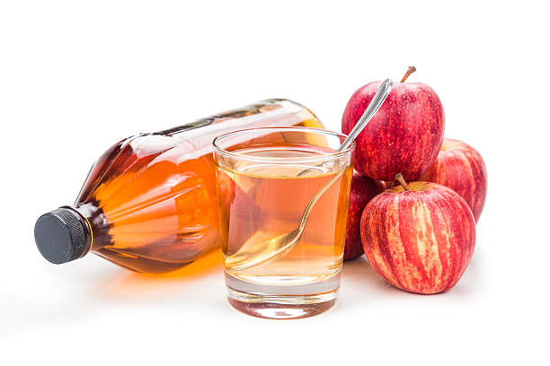 Apple cider vinegar with fresh apple as prop, healthy drink stock photo