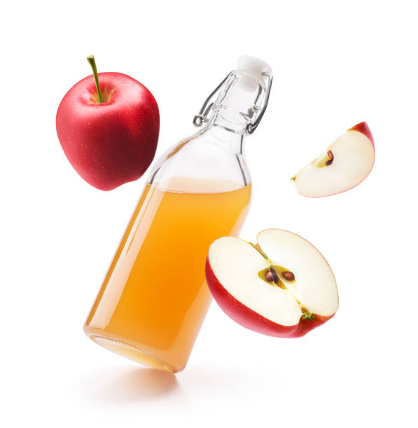 Apple cider vinegar with fresh red apples isolated on white background Apple cider vinegar with fresh red apples isolated on white background apple cider vinegar stock pictures, royalty-free photos & images