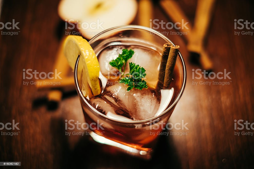 apple cider with cinnamon whiskey stock photo