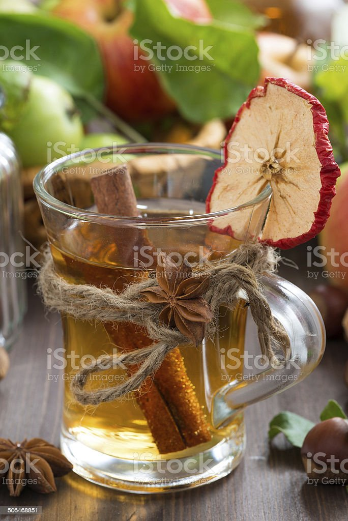 apple cider with spices in glass mug, vertical royalty-free stock photo