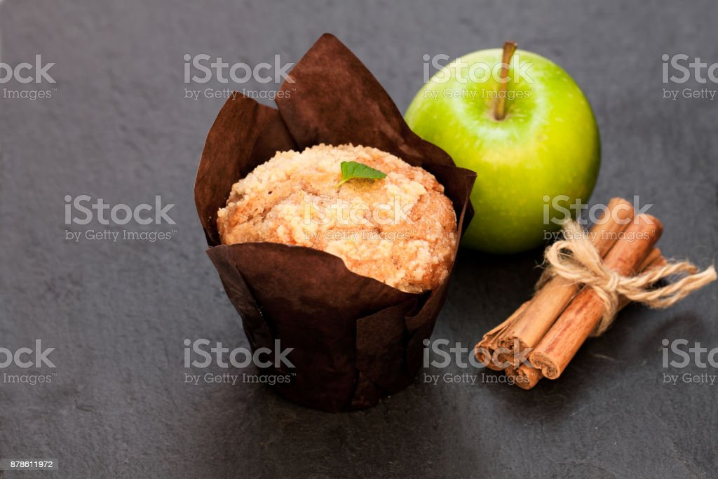 Apple  cinnamon muffins on black stone background stock photo