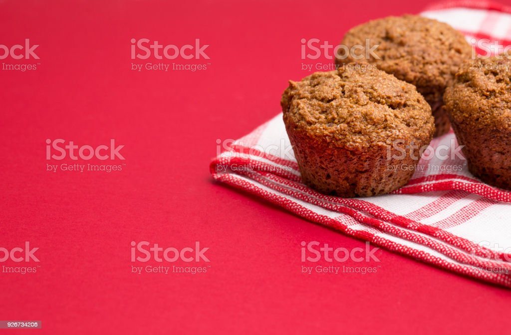 Apple Cinnamon Pecan Muffins on an Apple Red Background stock photo