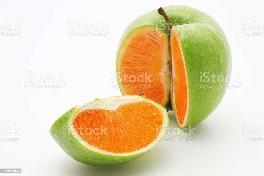 Apple containing an orange stock photo