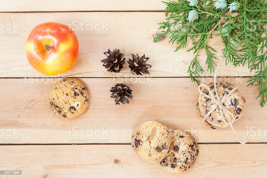 Apple, cookies with chocolate and red autumn leaves royalty-free stock photo