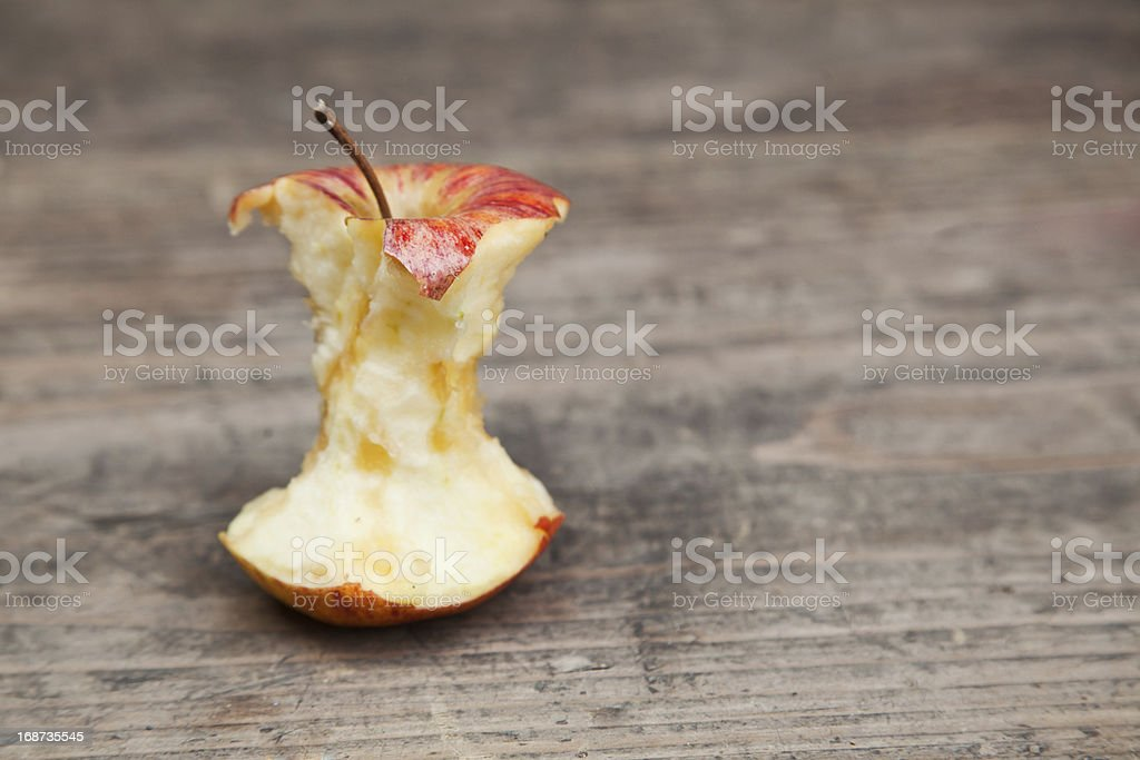 apple core on an old table stock photo