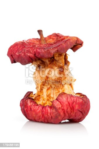 Red apple core on white background