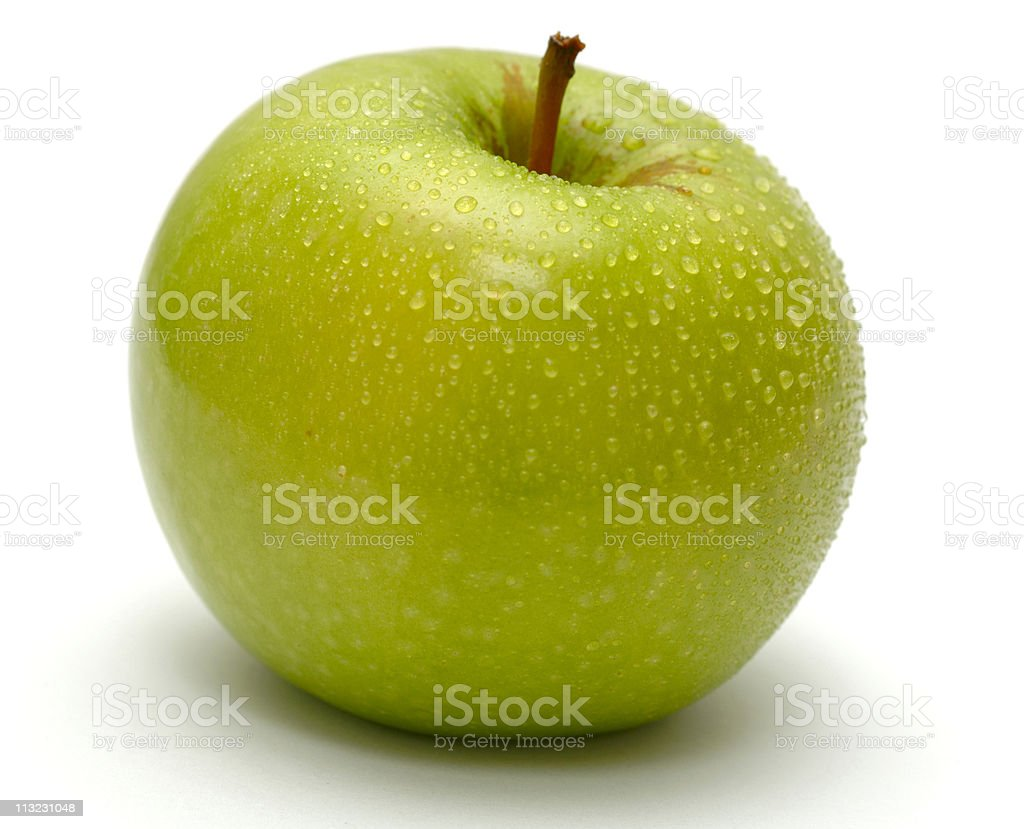 apple covered in water droplets against white royalty-free stock photo