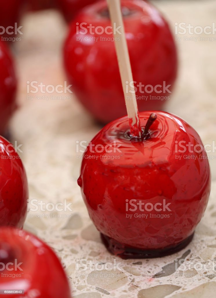 apple covered with red caramelized sugar stock photo