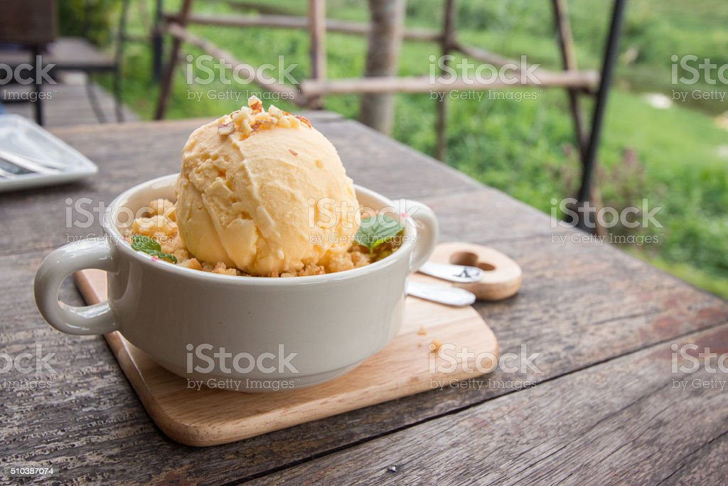 Apple crumble with vanilla ice cream on the top stock photo