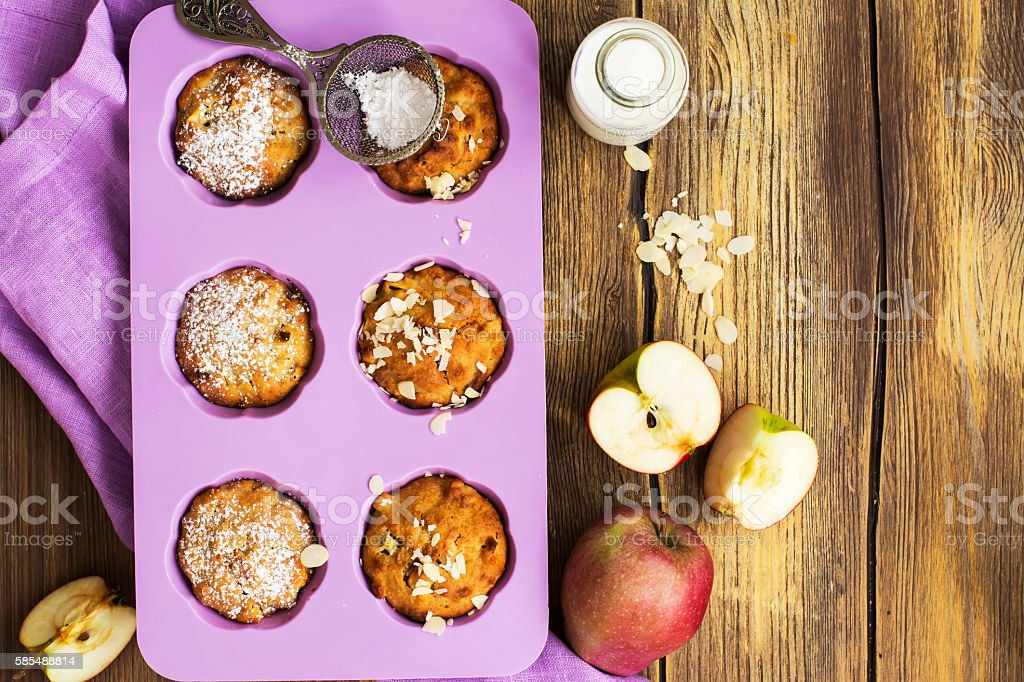 Apple cupcakes over wooden table stock photo