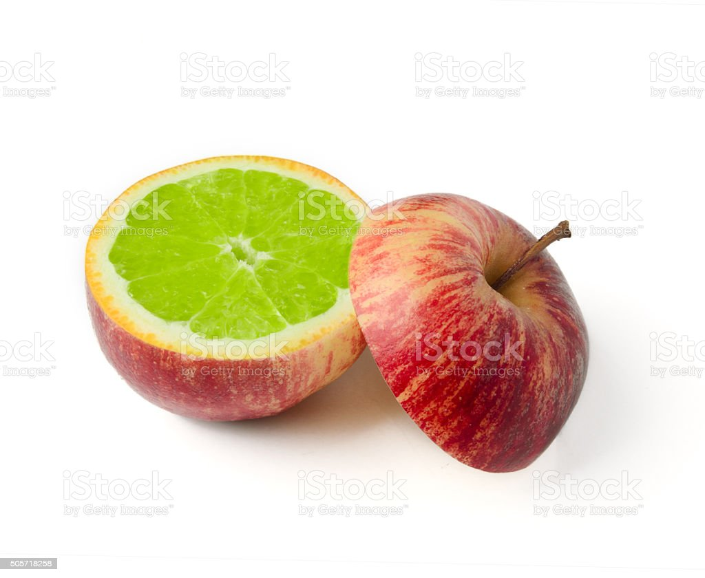 Apple cut with orange inside GMO concept genetically modified fr stock photo