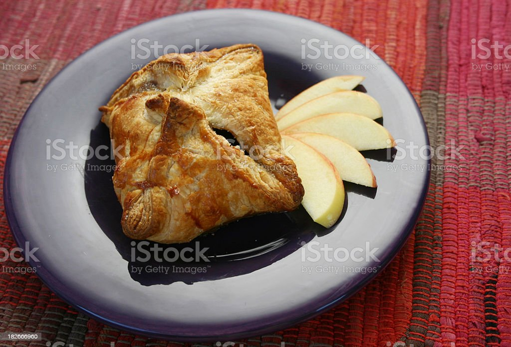 Apple dumpling presented on a purple plate  stock photo