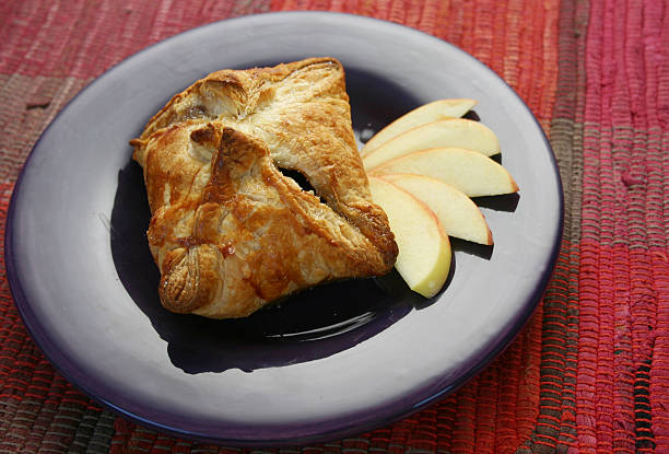 apple dumpling presented on a purple plate  - dumplings stock photos and pictures