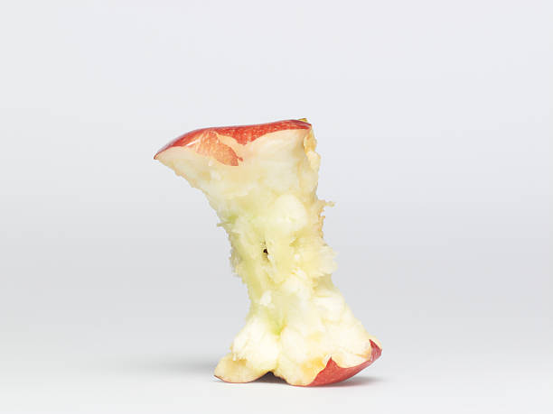 apple eaten - horse bit stock photos and pictures