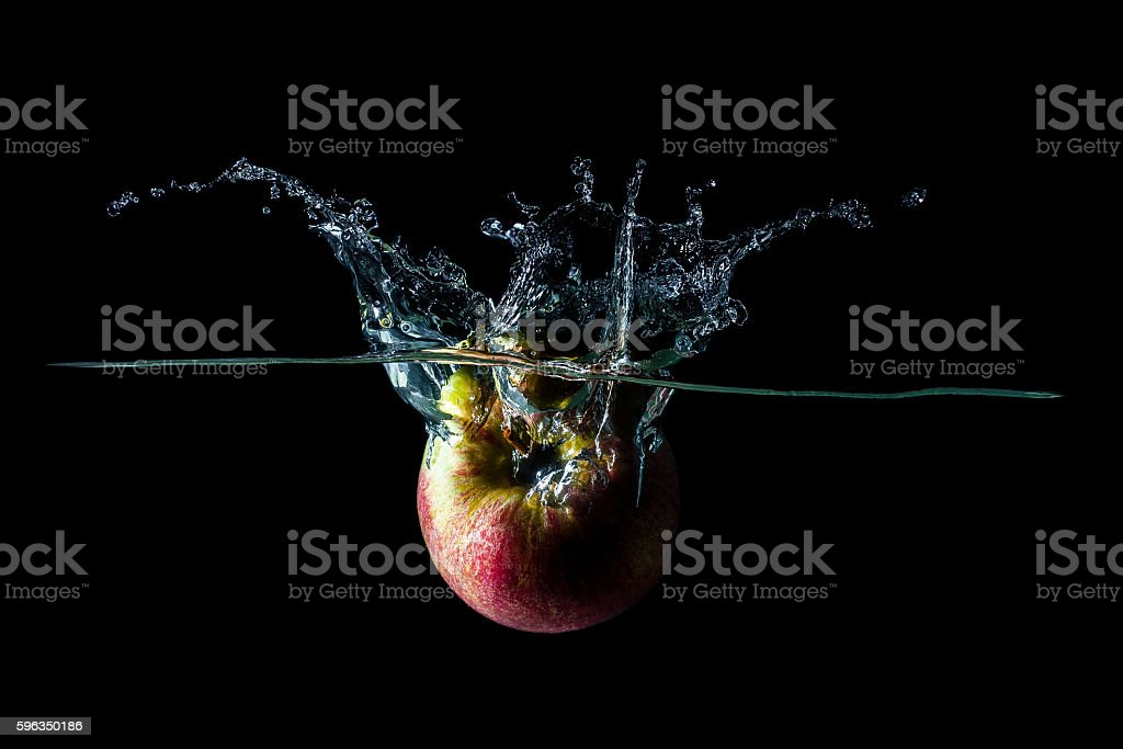 apple falls into the water royalty-free stock photo