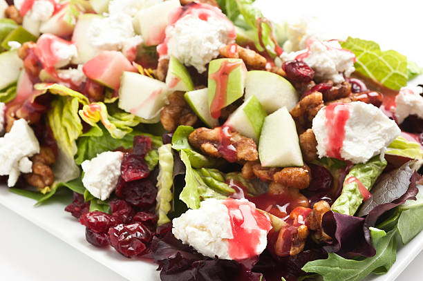 """Apple, feta and walnut salad.  """"Apple,feta cheese, and walnut salad with raspberry vinaigrette"""" vinaigrette dressing stock pictures, royalty-free photos & images"""