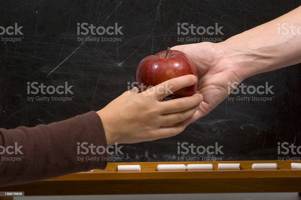 Apple for Teacher - handshake variation stock photo