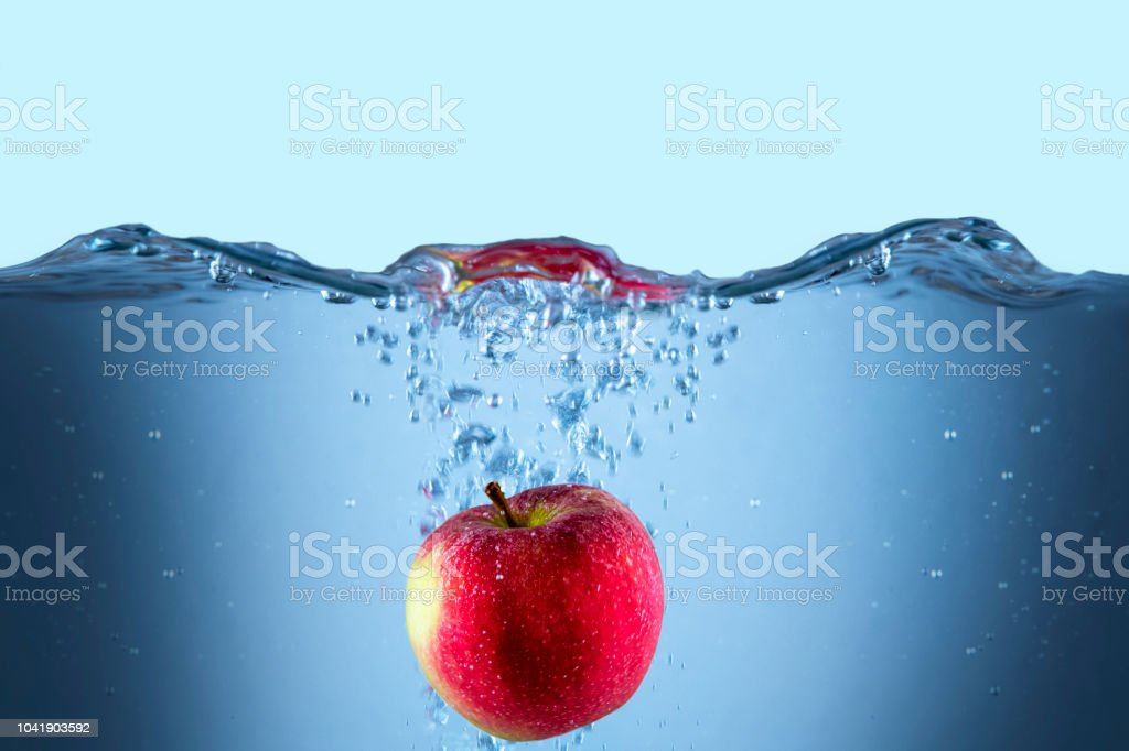Apple fresh red splash into the water,red fruit