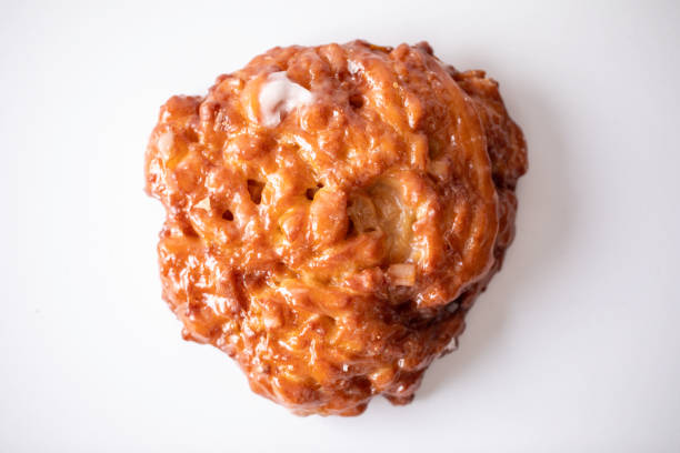 Apple Fritter Donut Apple fritter donut on a white background fritter stock pictures, royalty-free photos & images