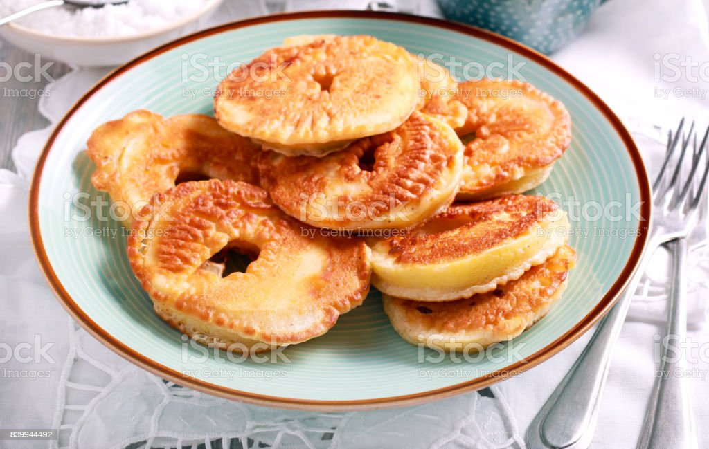 Apple fritters on blue plate stock photo