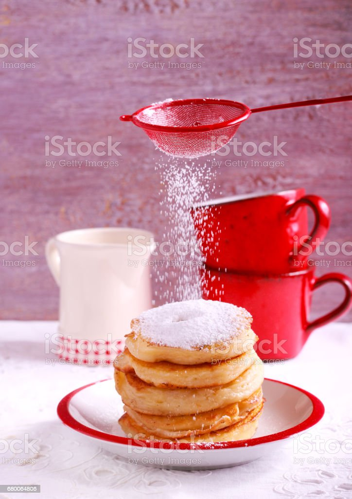 Apple fritters with powdered sugar stock photo