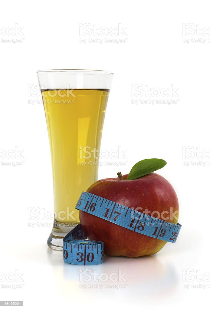 Apple, glass of juice and measuring tape. royalty-free stock photo