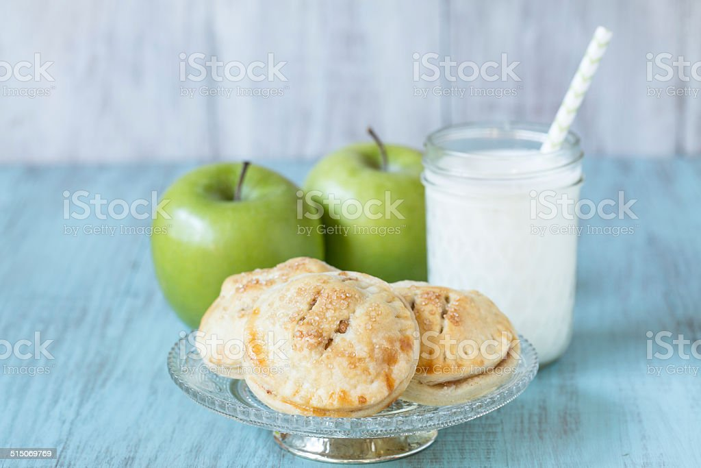 Apple Hand Pies With Glass Of Milk stock photo