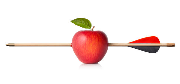 apple drabbats av pil - penetrating bildbanksfoton och bilder