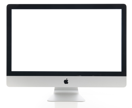 İstanbul, Turkey - July 22, 2014 : Apple iMac 27 inch desktop computer displaying blank white screen on a white background. iMac produced by Apple Inc.